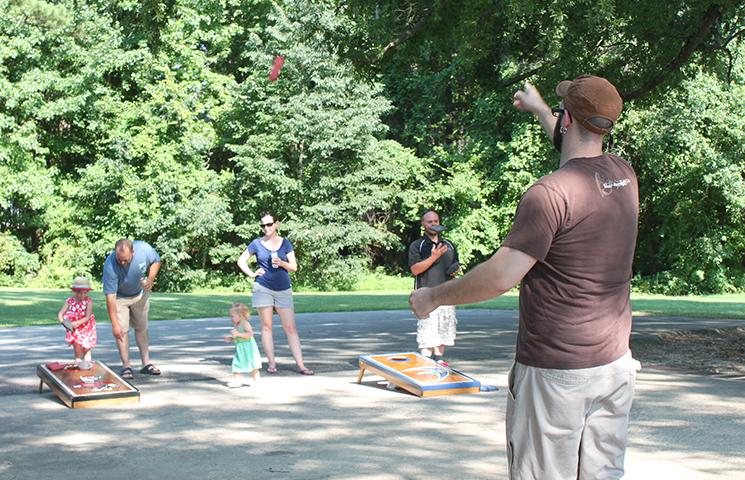 Playing corn hole at summer picnic