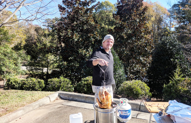 Christopher Burkhardt prepares the turkey for our Thanksgiving Feast.